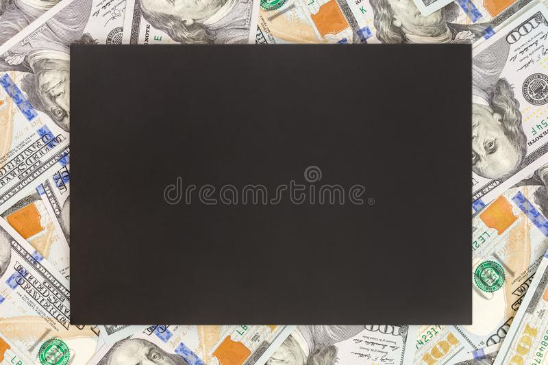 Money background with black mockup. Copyspace dark place for text. US currency one hundred dollar banknotes background. Financial,. Business and investments royalty free stock photo