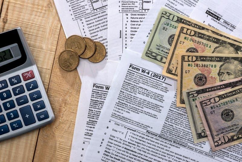 Money on the background of tax return. Money on the background of the tax return royalty free stock image