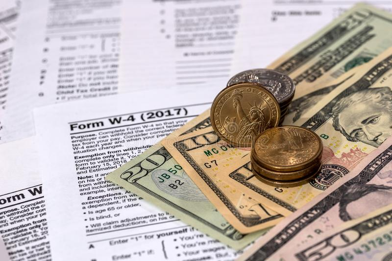 Money on the background of the tax return w 4 stock photo