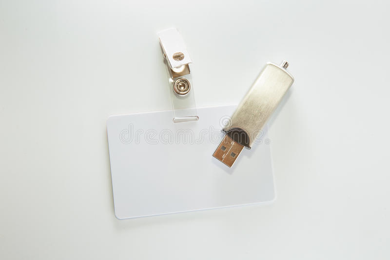 Money, badge and USB flash drive stock photography