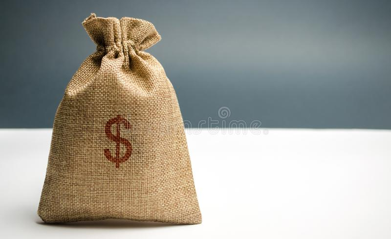 Money bag with a dollar sign. Family or company budget concept. Income and profit. The accumulation of capital. Salary savings. Pension payments. Cash savings royalty free stock images