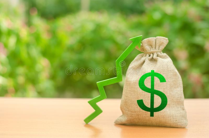 Money bag with dollar symbol and green up arrow. Increase profits and wealth. growth of wages. Favorable conditions for business. Investment attraction. loans stock photography