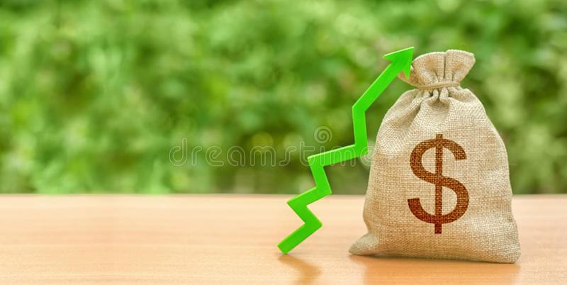 Money bag with dollar symbol and green up arrow. Increase profits and wealth. growth of wages. Investment attraction. loans. And subsidies. favorable conditions royalty free stock photo