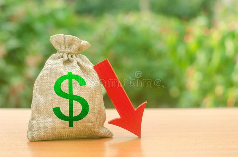 Money bag with dollar symbol and red arrow down. Reduced profits and liquidity of investments. Reduced tax revenues stock images