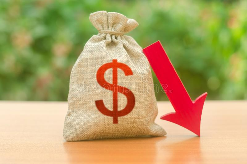 Money bag with dollar symbol and red arrow down. Reduced tax revenues, economic difficulties, departure of capital, investors. Falling wages and welfare. Low royalty free stock photos