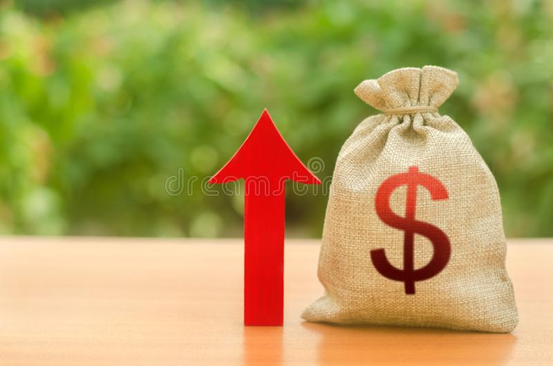 Money bag with dollar symbol and red up arrow. Increase profits and wealth. growth of wages. Investment attraction. loans. And subsidies. favorable conditions stock image