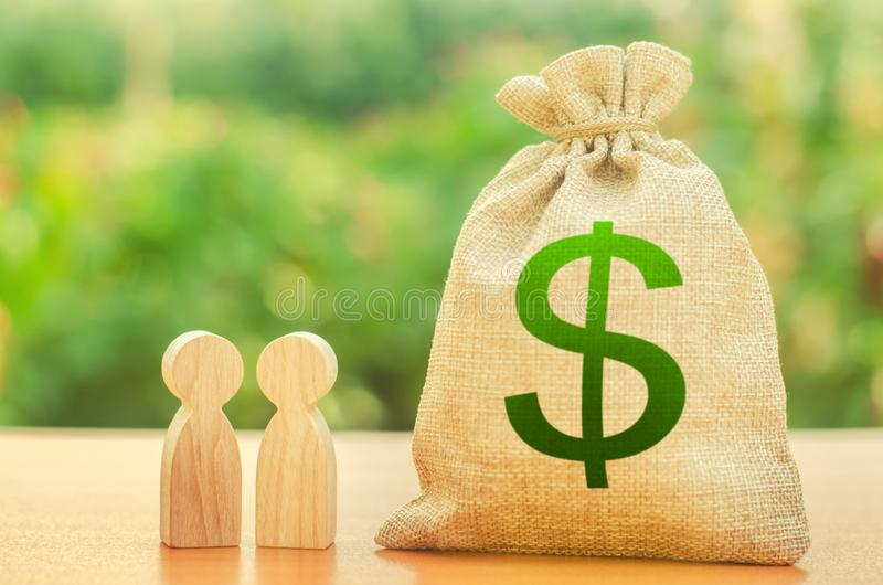 Money bag with dollar symbol and two people figures. Investment and lending, leasing. Business dispute and its solution stock images