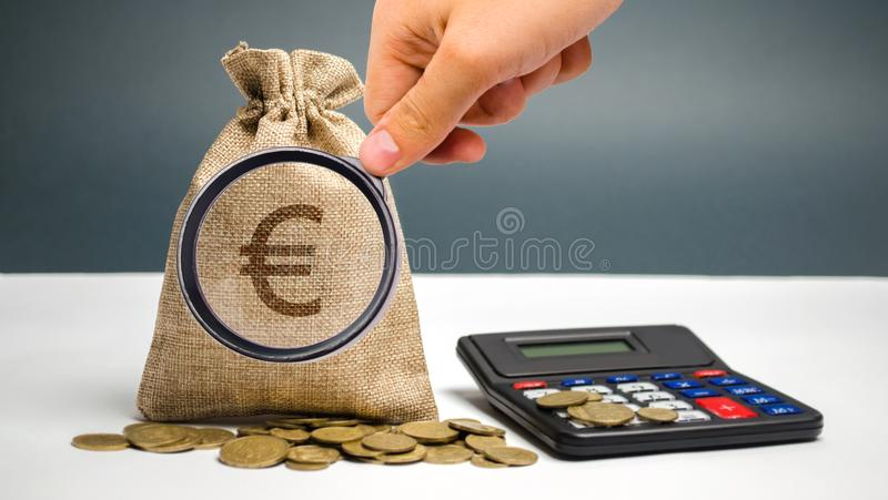 Money bag with a euro sign and calculator. Family or company budget concept. Income and profit. The accumulation of capital. Salary savings. Pension payments royalty free stock image