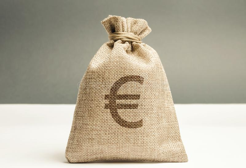 Money bag with a euro sign. Family or company budget concept. Income and profit. The accumulation of capital. Salary savings. stock photos