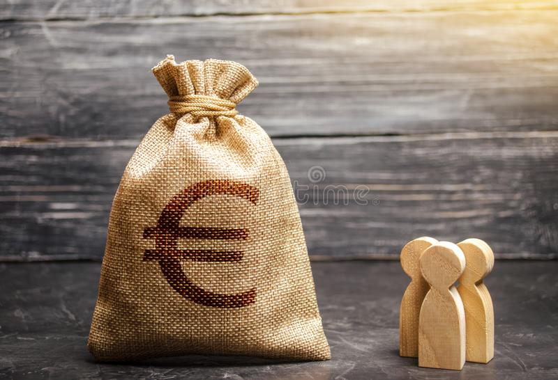 Money bag with a euro sign and people figurines. evaluation of the cost of the work of specialists and workers. concept royalty free stock images