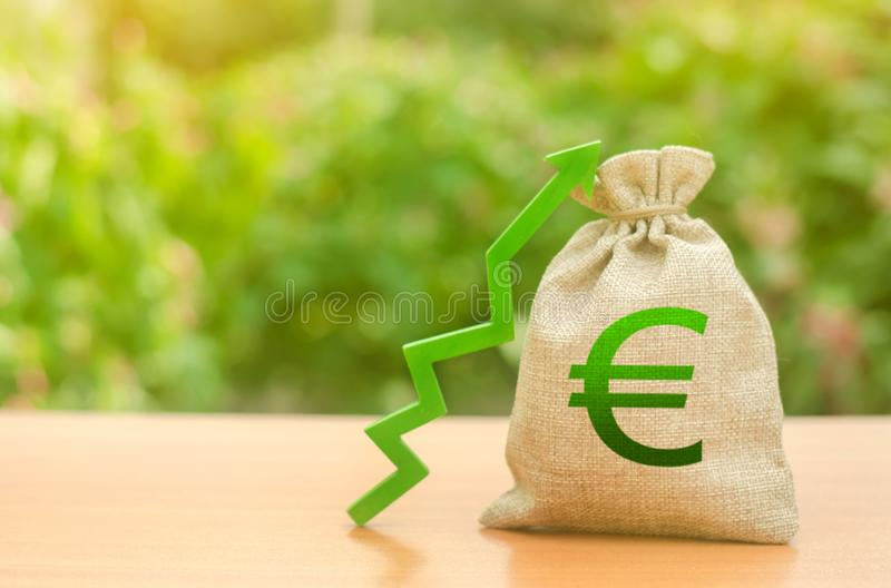Money bag with Euro symbol and green up arrow. Increase profits and wealth. growth of wages. Favorable conditions for business. Investment attraction. loans stock photo