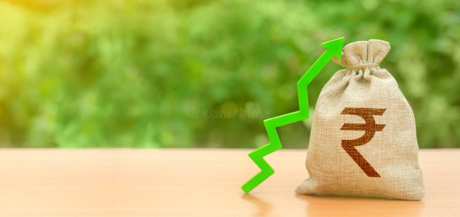Money bag with indian rupee symbol and green up arrow. The growth of the national economy and the strength of the exchange rate. Investment attraction. loans royalty free stock photos