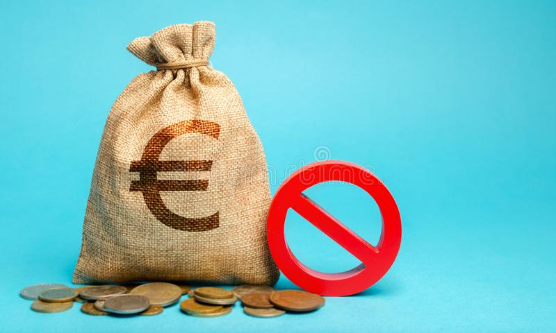 Money bag and sign of prohibition. Restrictions on the export of capital. Economic pressure and sanctions. Destabilization of the. Exchange market. Bad credit royalty free stock photography