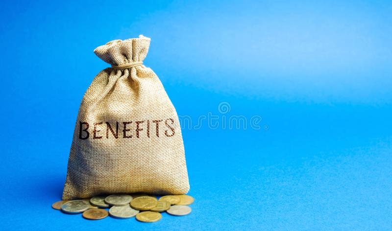 Money bag with the word Benefits. Profit from the investment. Getting business income and a good deal. Dividends. Successful. Profitable business. Performance stock photos