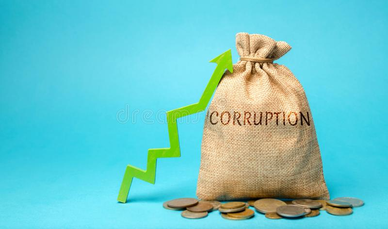 A money bag with the word Corruption and up arrow. Usurpation of power. Corrupt vertical. Damage to the economy. Poverty. Economic. Crime. Corrupt practices stock photos