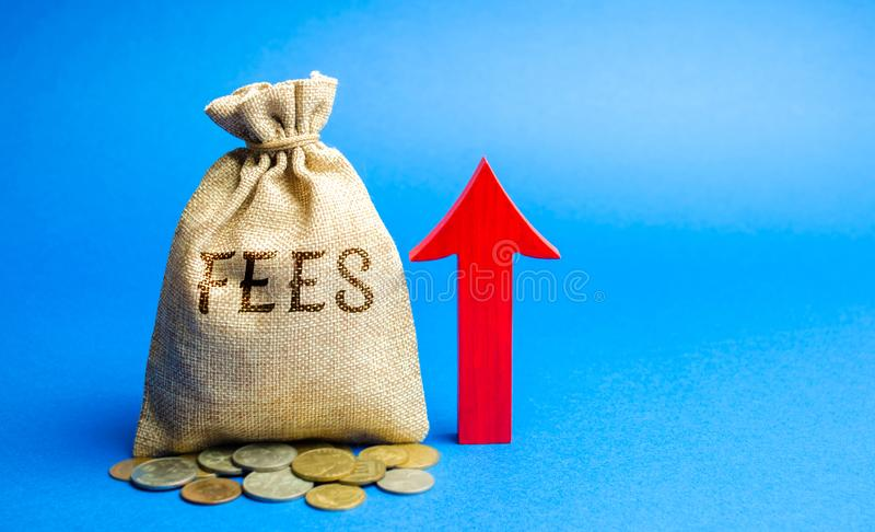 Money bag with the word Fees and up arrow. Duty increase concept. Trade wars. Import and export quotas. High taxation. Free. Trading zone. Business and Finance stock photos