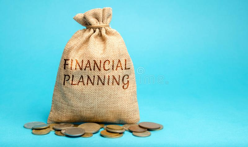 Money bag with the word Financial Planning. The plan of functioning and development of the enterprise. Business and finance. Concept. Budget, earnings, company royalty free stock image