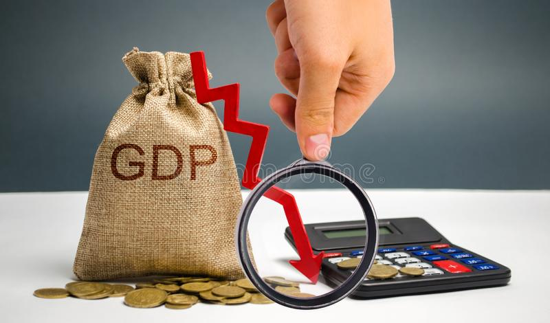Money bag with the word GDP and down arrow. Decline and decrease of GDP - failure and breakdown of economy and finances leading to stock photography