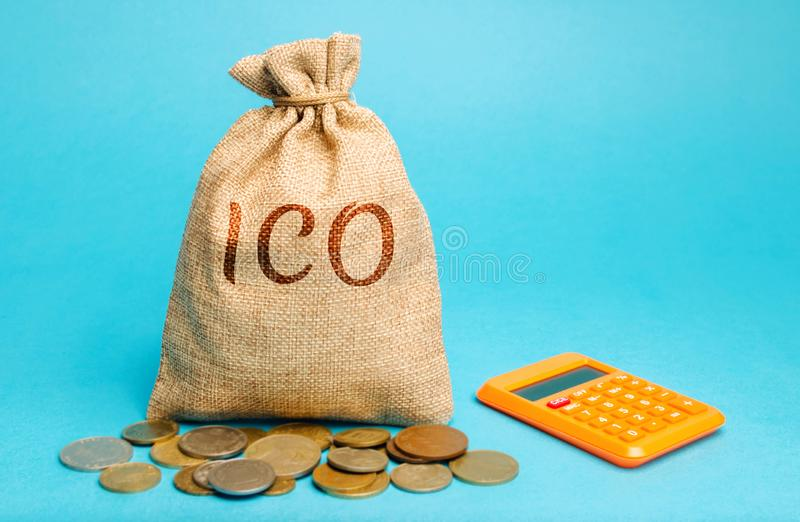 Money bag with the word ICO  Initial coin offering  and calculator. Attracting investments in the form of selling to investors a stock images