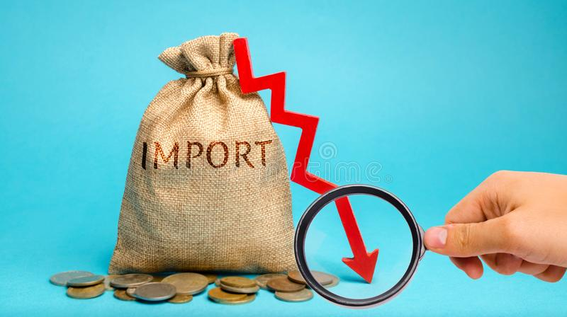 Money bag with the word Import and down arrow. The fall of imports. Reducing the competitiveness of imported goods. Sanctions and. Embargoes. Economic decline royalty free stock photography