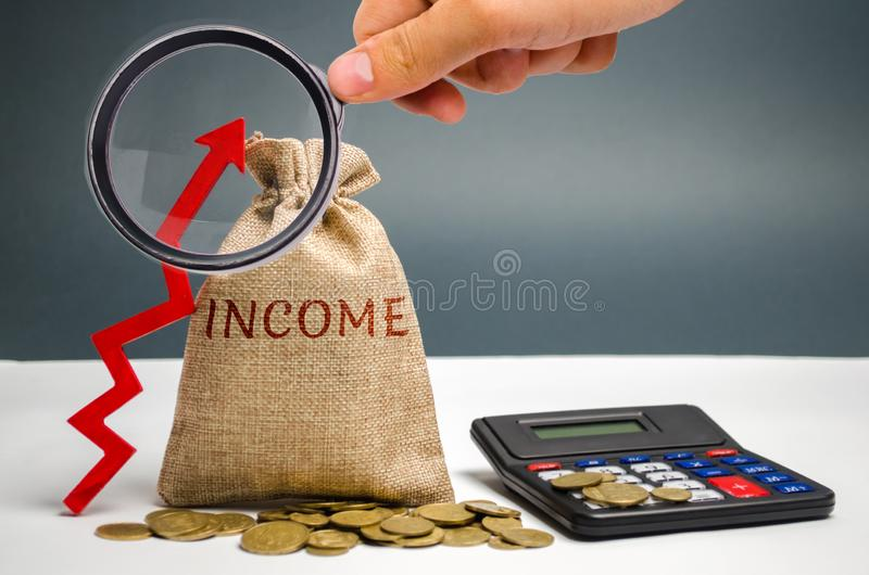 Money bag with the word Income and an up arrow. Concept of business success, financial growth and wealth. Increase profits and. Investment fund. Saving money royalty free stock photos