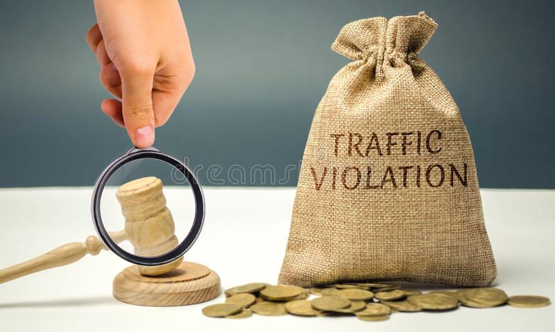 Money bag with the word Traffic violation and the judge`s hammer. Law. Court. Fine, legal fees. Traffic Tickets. Speeding. Failur. E to yield. Turning into the stock photo