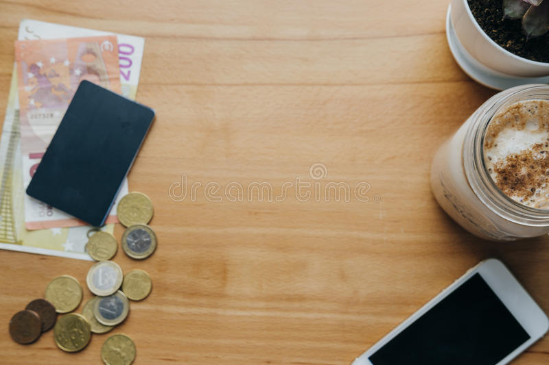 Money, bank cards, phone, coffee on the table. Concept online sh stock photography