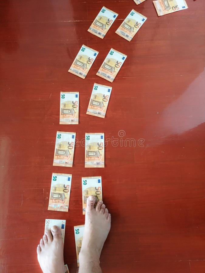 Money bank notes on the floor, best way to follow to get money, walking on the money walkway royalty free stock photo