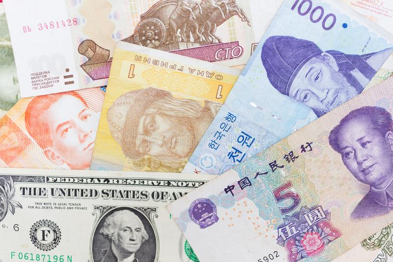 Money banknotes of different countries or currency exchanging background royalty free stock images