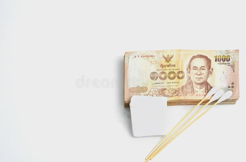 Money banknotes with gauze and cotton bud in health or accident stock image