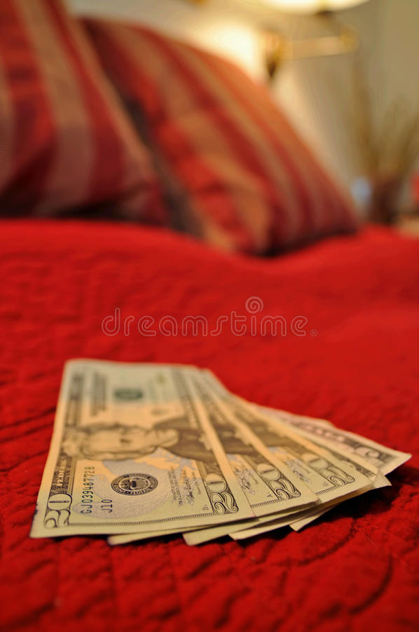 Money on the bed stock image