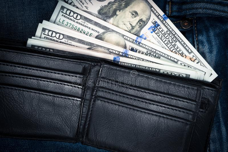 Money in black leather wallet with empty credit card slots place stock photos