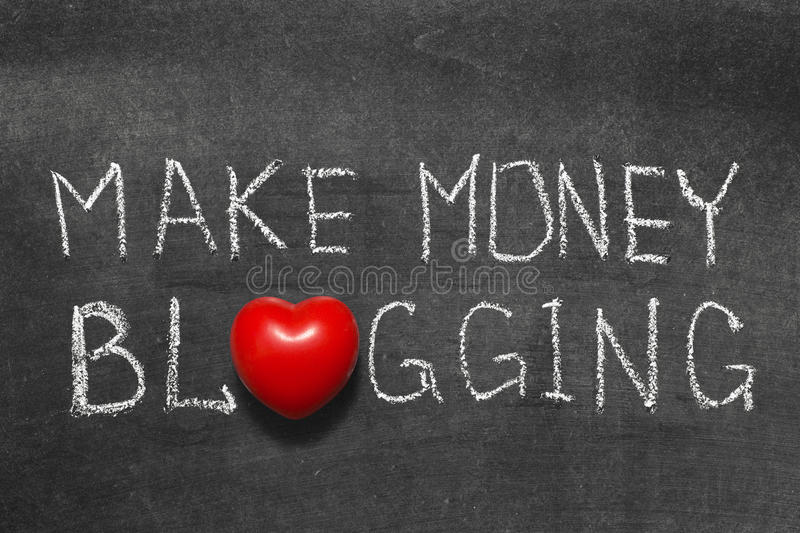 Money blogging. Make money blogging phrase handwritten on blackboard with heart symbol instead of O stock photography