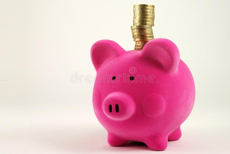 Money Box with stack of Coins stock photo