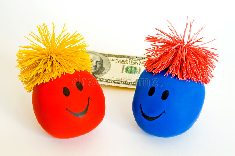Money Brings Bright Smiles!. Two colorful toy smiley faces sit on a white background in front of a 100 dollar bill (US stock photos