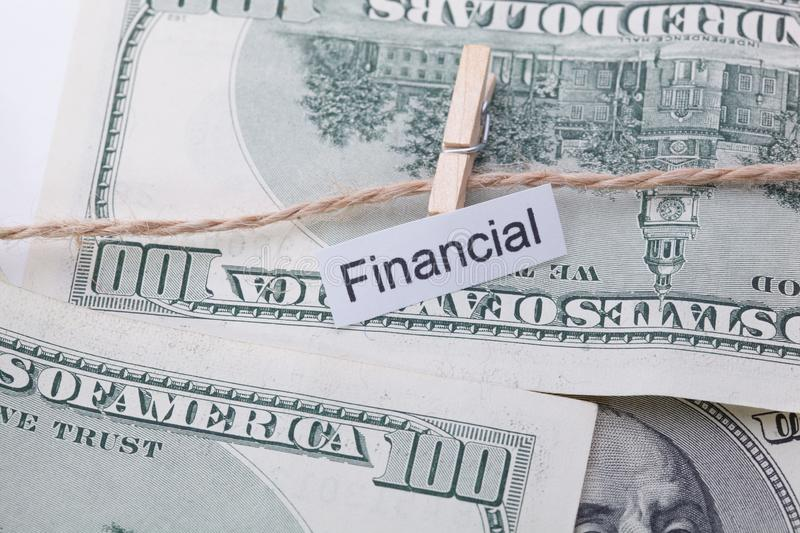 Money and business idea, The dollar bills with rope, with a sign - Financial. Money and business idea, The dollar bills with rope, with a sign - Financial stock photos