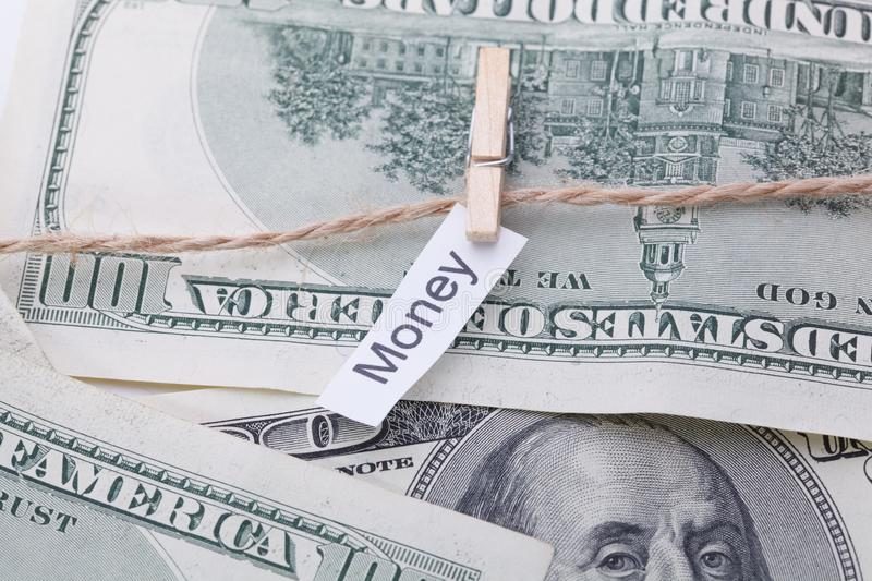 Money and business idea, The dollar bills with rope, with a sign - Money. Money and business idea, The dollar bills with rope, with a sign - Money royalty free stock photography