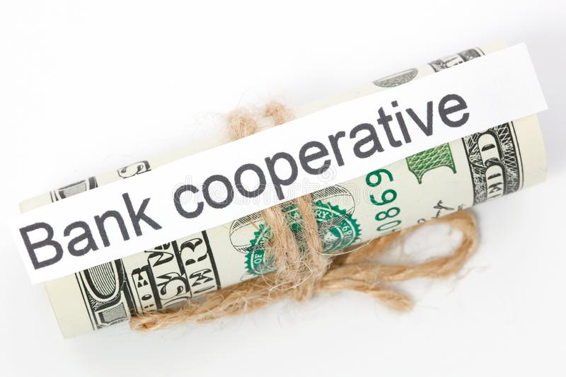Money and business idea, The dollar bills tied with a rope, with a sign - Bank cooperative. Money and business idea, The dollar bills tied with a rope, with a royalty free stock images