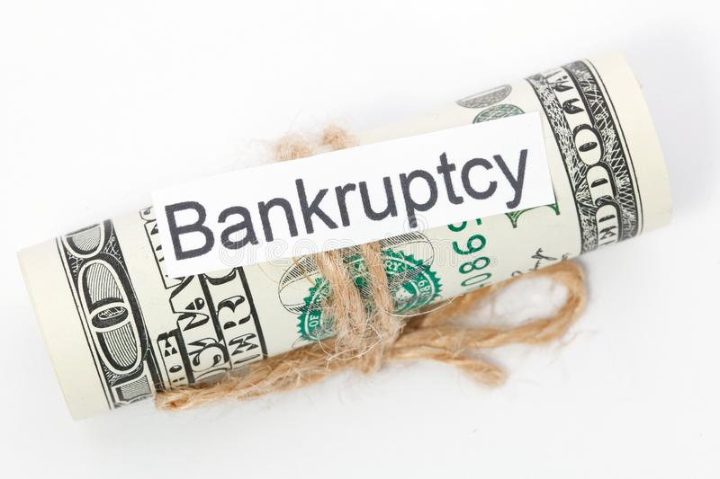 Money and business idea, The dollar bills tied with a rope, with a sign - Bankruptcy. Money and business idea, The dollar bills tied with a rope, with a sign royalty free stock photo