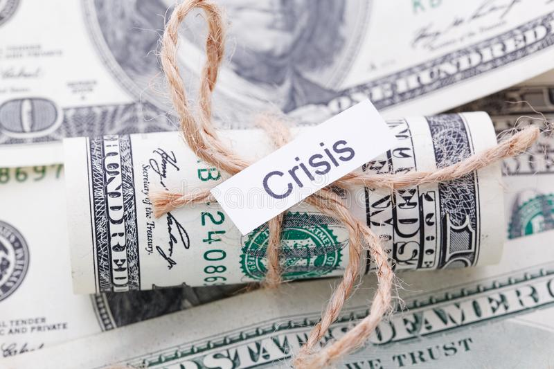 Money and business idea, The dollar bills tied with a rope, with a sign - Crisis. Money and business idea, The dollar tied with a rope, with a sign - Crisis stock photos
