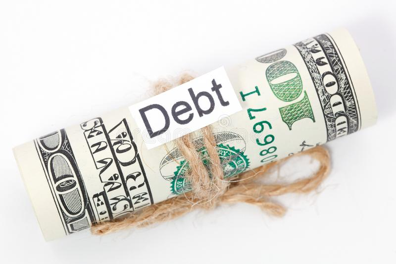 Money and business idea, The dollar bills tied with a rope, with a sign - Debt. Money and business idea, The dollar bills tied with a rope, with a sign - Debt royalty free stock photos
