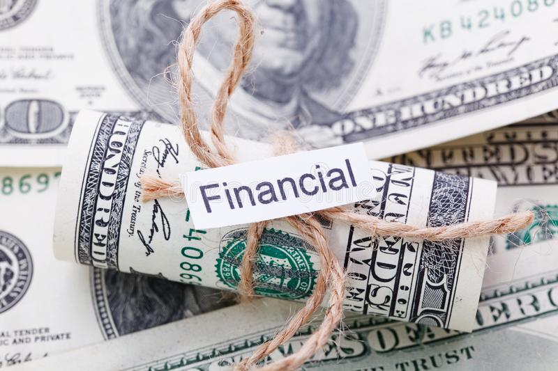 Money and business idea, The dollar bills tied with a rope, with a sign - Financial. Money and business idea, The dollar bills tied with a rope, with a sign stock photography