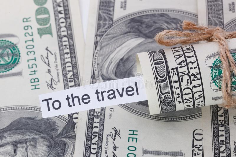 Money and business idea, The dollar bills tied with a rope, with a sign - To the Travel. Money and business idea, The dollar bills tied with a rope, with a sign royalty free stock images
