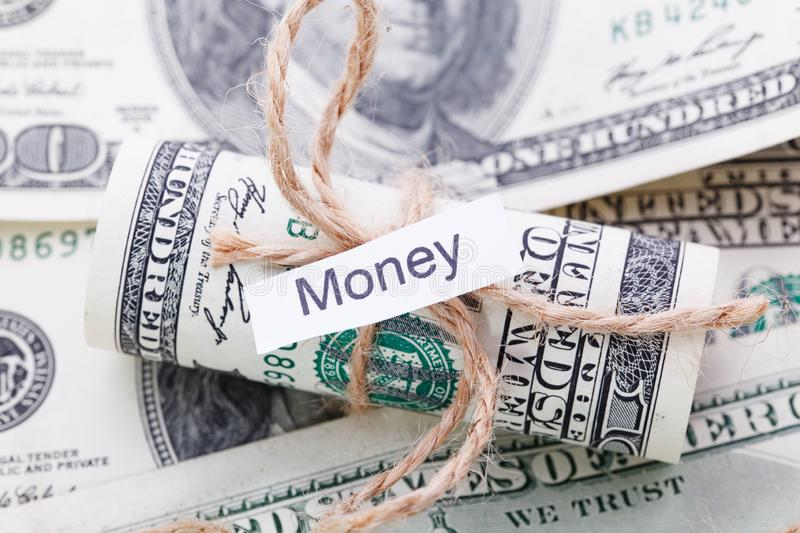 Money and business idea, The dollar bills tied with a rope, with a sign - Money. Money and business idea, The dollar tied with a rope, with a sign - Money stock photos