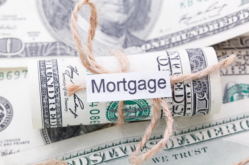 Money and business idea, The dollar bills tied with a rope, with a sign - Mortgage. Money and business idea, The dollar tied with a rope, with a sign - Mortgage royalty free stock photos