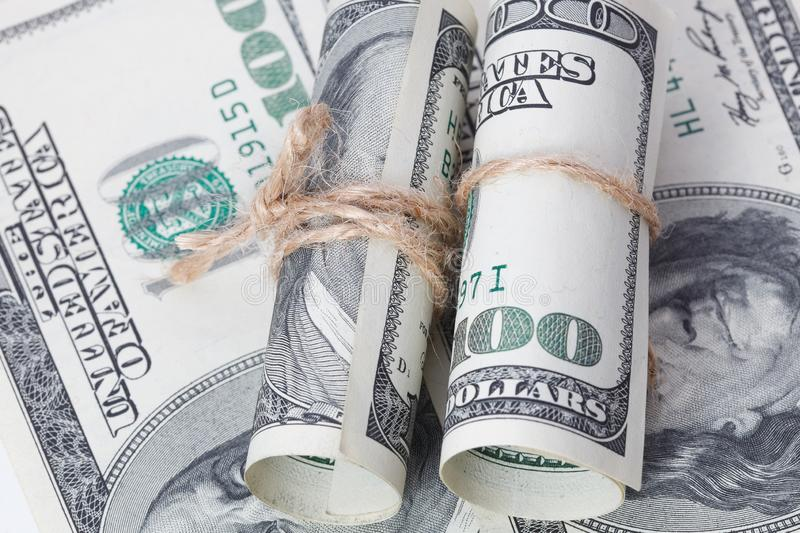 Money and business idea, The dollars bills tied with a rope. royalty free stock photo