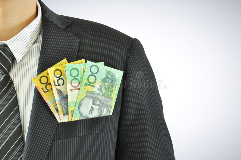 Money in businessman pocket suit - AUD - Australian Dollars royalty free stock photos