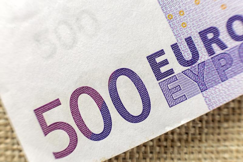 Money, busyness and finances concept. Detail part of five hundred banknote euro national currency bill. Symbol of wealth and stock image