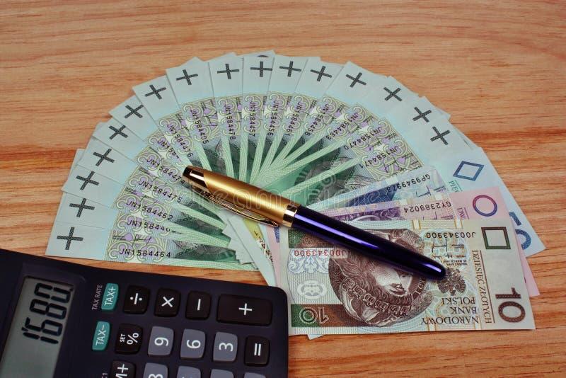 Money calculator pen. Polish money calculator pen on the table stock image