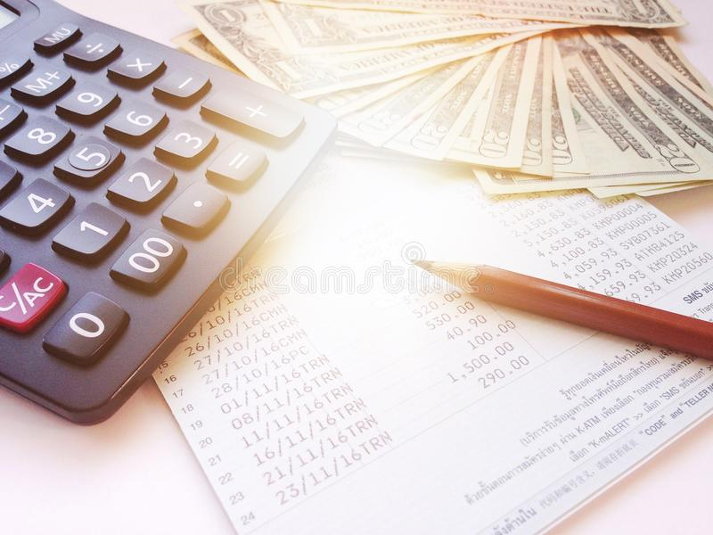 Money Calculator And Pencil On Saving Account Passbook Or Financial